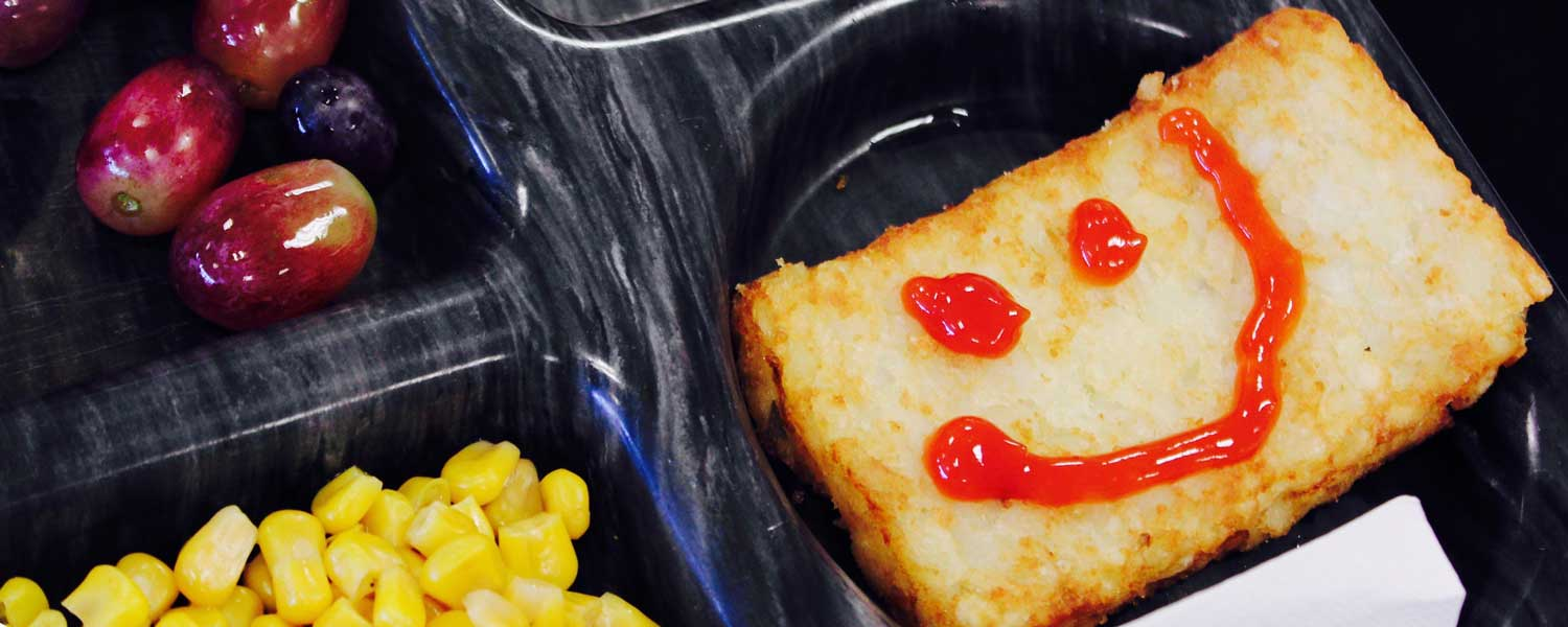 lunch tray with smiling food