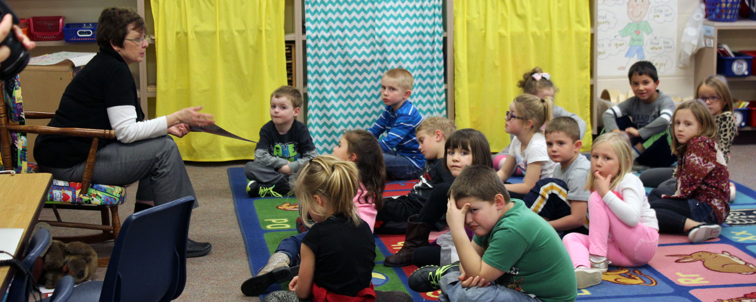 first grade teacher speaking to students in class