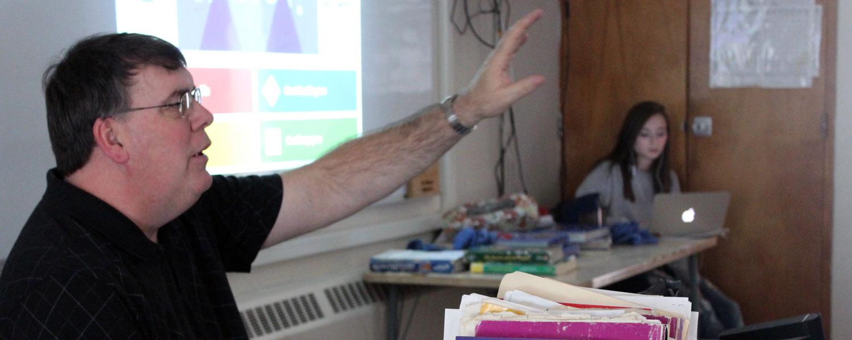 social science teacher speaking to class
