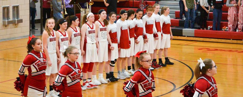 girls basketball team and cheerleaders
